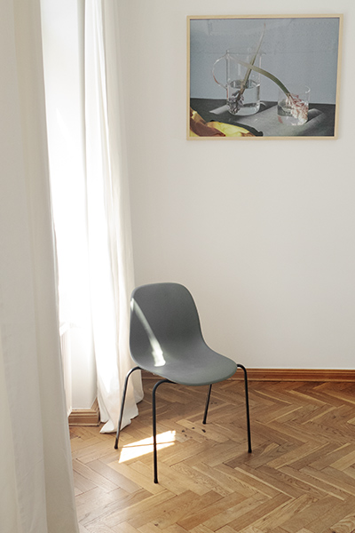 chair CHAYR with dark green plastic shell and black metal legs in living room by MYCS