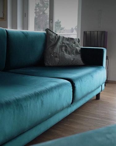 blue velvet sofa with cushion