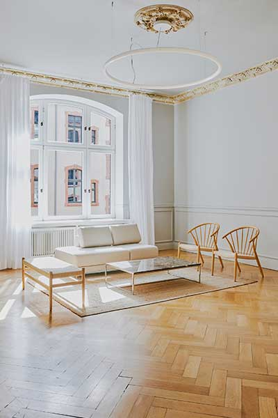 sofa TYME white and side table SYDE with marble tabletop and metal legs by MYCS shown in classic interior